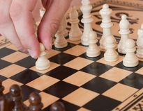 Chess. Board with man hand stock photography