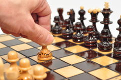 Chess. The first move made by player Royalty Free Stock Photo