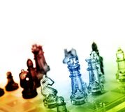 Chess. Game of glass chess pieces royalty free stock image