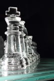 Chess. Transparent chess pieces with glass chess board stock images