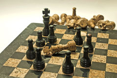 Chess. Checkmate, leaders should not isolate their teams from getting involved in the game (Business Stock Photo