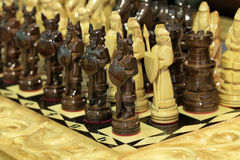 Chess. Wooden chess pieces on a wooden board royalty free stock photo