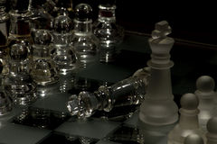 Chess. One piece playing chess with checkmate Royalty Free Stock Photo