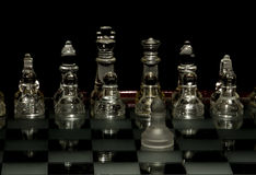 Chess. One piece playing chess with checkmate Royalty Free Stock Images