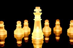 Chess. Some chess pieces illuminated by orange light Stock Photo