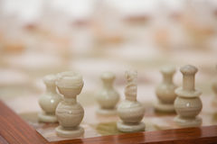 Chess. Pieces on a board made out of marble Royalty Free Stock Image