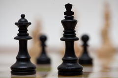 Chess. Pieces on a board made out of marble Royalty Free Stock Photography