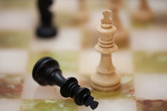 Chess. One king ist standing and the other king lies on the ground. Whte won Stock Images
