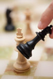 Chess. A person ist about to beat the king and win the game Royalty Free Stock Photo
