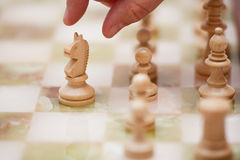 Chess. A chess player moves his knight Stock Photo