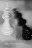 Chess. One king is standing and the other king is falling to the ground. black and white. blurred Royalty Free Stock Images