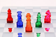 Chess. Group of color glass chess piece Stock Photos