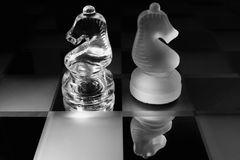 Chess. Two glass chess figures, black and white Royalty Free Stock Image
