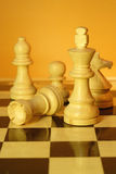 Chess. A game of chess comes to an end. when the king is checkmated, and the other party is victorious Royalty Free Stock Images