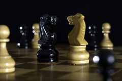 Chess. Figure on a  board stock photos