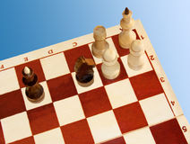 Chess. Isolated on a blue background. Black move Kc2+... It is mate Stock Photos