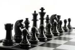 Chess. Black chessmen on a chessboard stock image