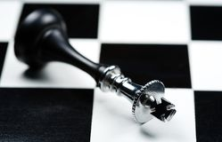 Chess. Fallen king royalty free stock image