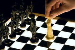 Chess. Mans hand with a white queen Stock Photos