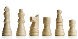 Chess. White's wooden chess figures on white Royalty Free Stock Image