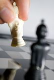 Chess. Hand move in chess game Royalty Free Stock Photography