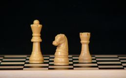 Chess. Pieces on a wood  board royalty free stock photography
