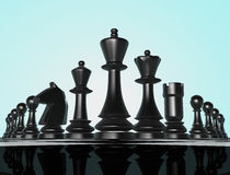 Chess. Black chess figures on chess board Royalty Free Stock Images