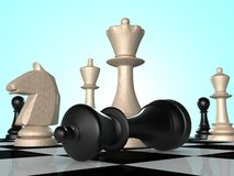 Chess. Black chess king falling down Royalty Free Stock Photo