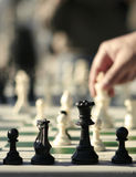 Chess. A Chess Game With Hand In Decision Stock Photo
