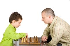 Chess. Father and son playing chess Stock Photos
