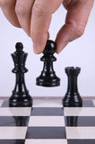 Chess. Player making his move Royalty Free Stock Photos