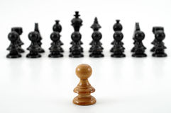 Chess. White pawn against oponent army on white background Stock Photos