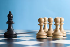 Chess, adversity. A challenge, group of pawns ganging up on other chess piece Stock Photos