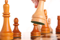 Chess aggression hand human white Royalty Free Stock Images