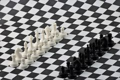 Chess is an ancient logical strategy game. Chess is a logic Board game with special pieces on a 64-cell Board for two opponents, combining elements of art royalty free stock photo
