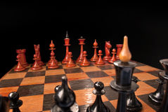 Chess armies. On a chessboard in a black space Royalty Free Stock Photos