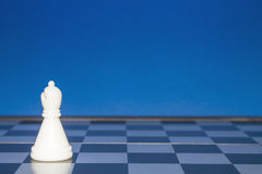 Chess as a policy 2. Chess as a policy. White figure on a blue background Stock Images