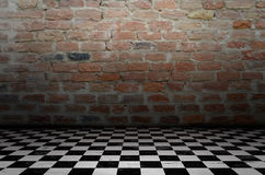 Chess background interior in a dark room and brick wall Royalty Free Stock Photography