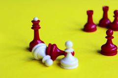 Chess Queen. Strategy game. Red And white Piece. Chess Background. Red And White Chess on Yellow Background. Chess Business Concept, Success.Chess Figures royalty free stock photography