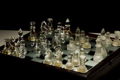 Chess and battle. A mate chess in the table Stock Images