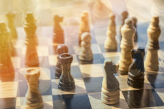 Chess battle in business concept investment and financial advisor photo blurred with copy space and overlay. royalty free stock photo