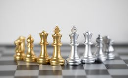 Chess battle about Gold and Blond on chess board. Chess board is the intelligence strategy game to make ideas for business and marketing concept, the success royalty free stock photos