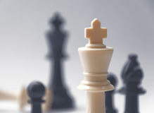 Chess battle - the king - plastic chess pieces - kings, bishop, pawns Stock Image