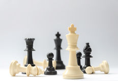 Chess battle - plastic chess pieces - king, queen, bishop, pawns - selective focus Stock Photos