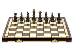 Chess battle on wood board on white background Stock Images