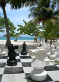 Chess on beach. This is the image on big chessboard and chessmen on resort beach Royalty Free Stock Photography
