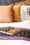 Chess on bed in hotel room Royalty Free Stock Photos