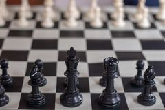 Chess beginning closeup Black King and Queen royalty free stock photography