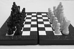 Chess. Beginning of the game.The chess pieces are placed on the chessboard. Black and white Royalty Free Stock Images
