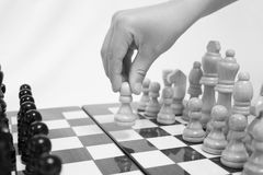 Chess. Beginning of the game.The chess pieces are placed on the chessboard. Black and white. First step Stock Image